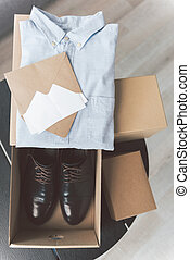 Different boxes with clothes and footwear - Top view various...