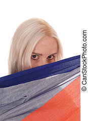 Woman hiding behind soma fabric - A beautiful blond woman...