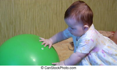 baby playing with green ball - small baby play with big...