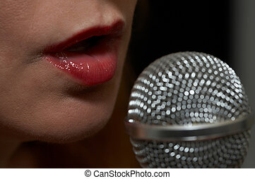 Lady sings the blues - Woman singing into a microphone -...