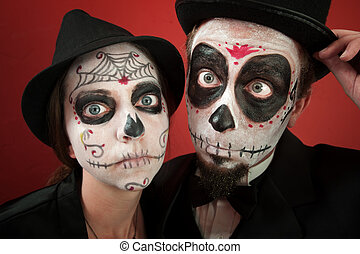 Couple on All Souls Day - A Classy Couple wearing skull...