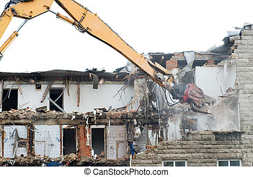 demolition works - demolition excavator at work on an old...