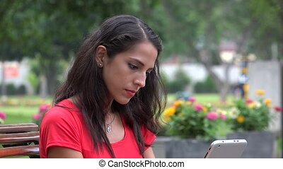 Young Woman Using Tablet Device