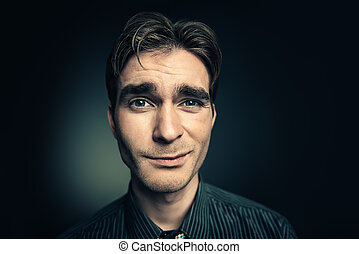 humorous male face - Funny young man looking at camera....