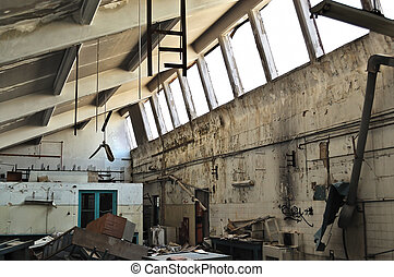 abandoned factory ruins - Vandalized equipment and decaying...