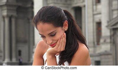 Sad Young Hispanic Woman