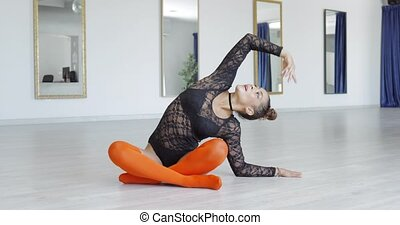 Young sportive dancer stretching in studio - Young fit...