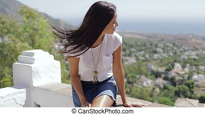 Content woman enjoying view of city - Pretty brunette in...