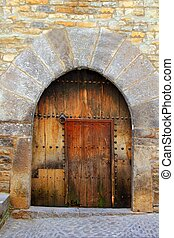 Romanesque arch door wooden medieval Ainsa