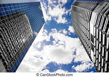 Glass and steel - Two skyscapers tower above one of steel...
