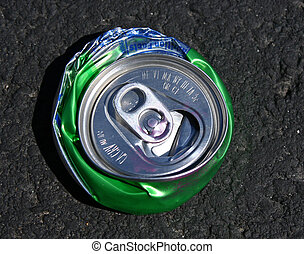 top view of crushed aluminum soda c - top view of flattened...