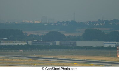 Wide-body airplane landing - Wide-body four-engine airplane...