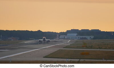 Airplane landing at the early morning - Airplane lands on...