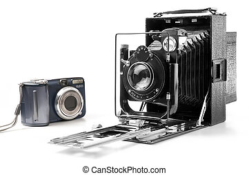 Technological development - Old and modern camera isolated...