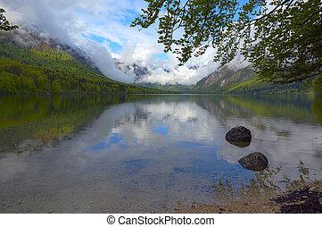 Bohinjsko jezero between mountains at spring - Bohinjsko...