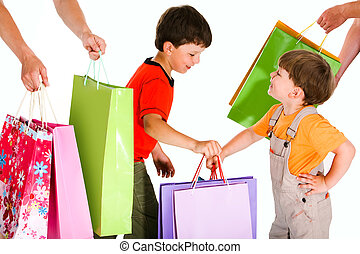 Little shoppers - Portrait of two happy boys holding...