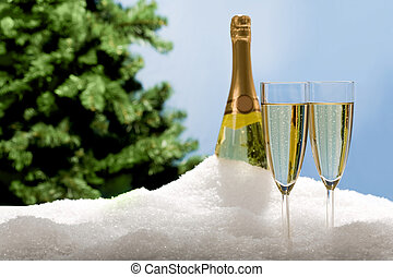 Champagne flutes in snow - Photo of two champagnes with...