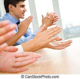 Success - Photo of happy business partners hands applauding...