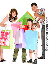 Joyful shopping - Image of cheerful family members standing...