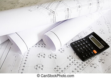 Calculations - Close-up of blueprints with sketches of...