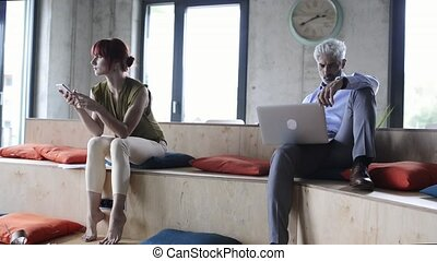 Business people in creative office working. - Two business...