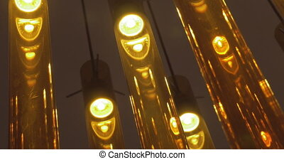 Illumination of brown glass tube lamps - Close-up shot of...