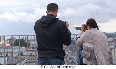 Woman travel and viewing with tourist binocular in Saint...