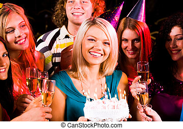 Girl with birthday cake - Portrait of joyful girl holding...