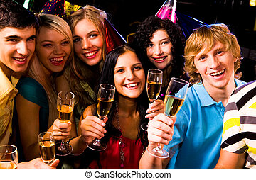Friends - Portrait of happy friends with champagne at...
