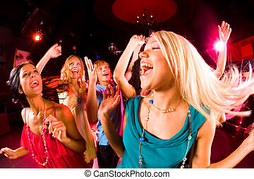 Energetic girl - Portrait of cheerful girl dancing at party...