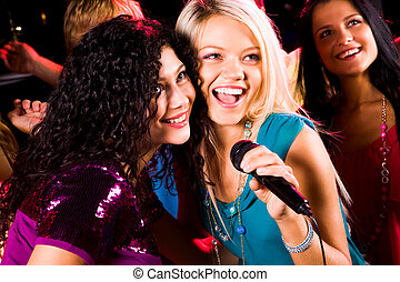 Singing girls - Photo of pretty girls with microphone...