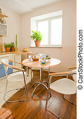 Kitchen - Photo of round table and two chairs near by in the...