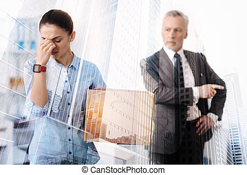 Young unemployed woman crying in the office