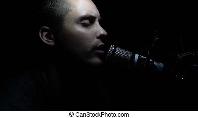 Man singing In Recording Studio with microphone.