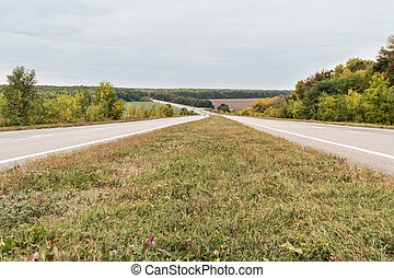Two-lane road leaving into the distance - Two-row high-speed...