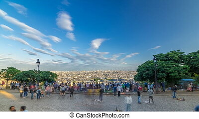 Tourists near Sacre coeur de Montmartre cathedral timelapse....