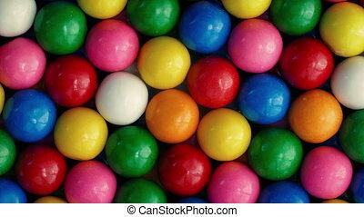Bubblegum Balls Rotating Closeup - Many colorful gumballs...