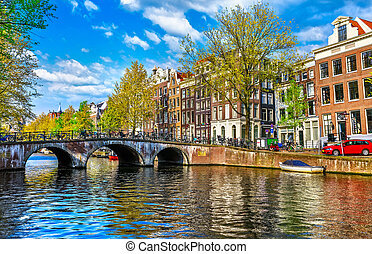 Bridge over channel in Amsterdam Netherlands houses river...