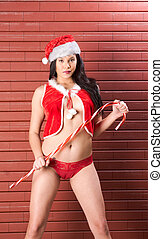 Sexy seductive Asian Mrs. Claus in Christmas costume -...