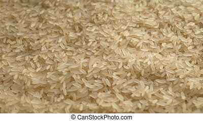 Pile Of Rice Grains - Raw white rice in pile turning slowly