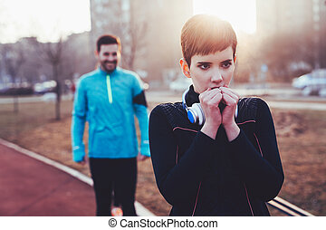 Woman fitness exercising in cold weather outdoor - Beautiful...