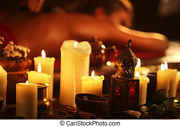 Massage of woman in spa salon. Luxary interior oriental...