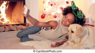 Cute young woman taking a selfie with her dog - Cute young...