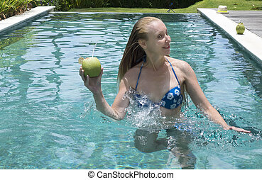 young attractive woman with long hair in a swimwear in the...