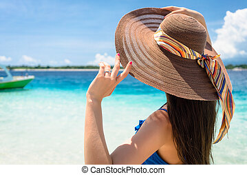 Woman at beach by the ocean relaxing in her vacation - Woman...