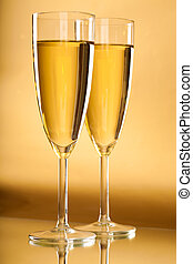 Golden anniversary - Image of two full champagne flutes over...