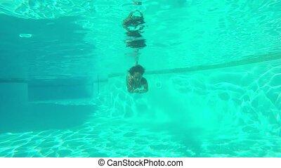 Woman posing underwater in pool - Shot taken underwater of...
