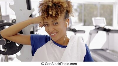Charming girl posing in gym - Portrait of young curly model...