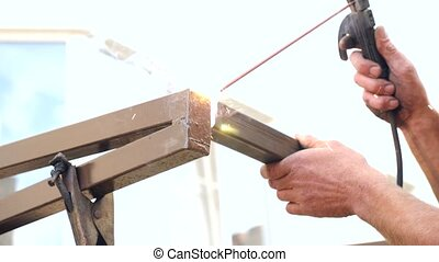Industrial worker welding high at the construction site in...