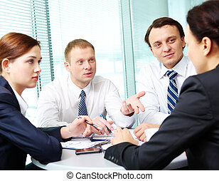 Debating - Image of confident colleagues listening to new...